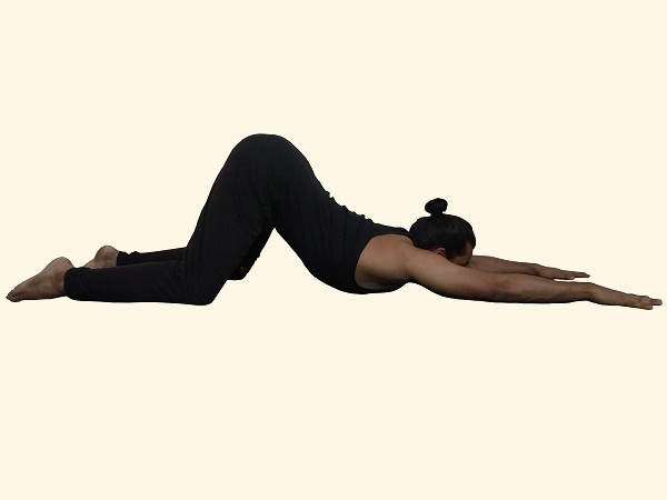 shoulder-chest-opener-on-ground-yin-stretch-yoga-posture